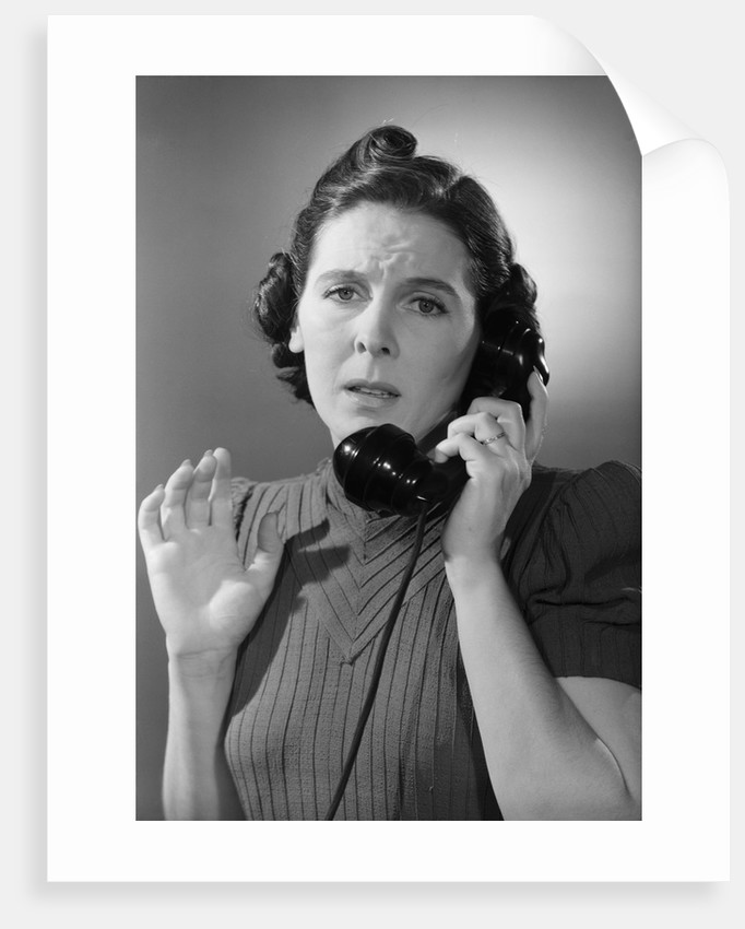 Anxious Woman On The Telephone by Corbis
