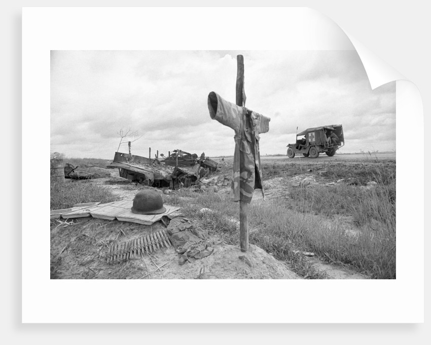 Ambulance Driving By Grave With Cross by Corbis
