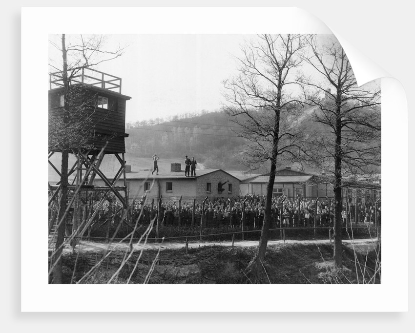 Wwii Pow Crowd Cheering Behind Fence by Corbis