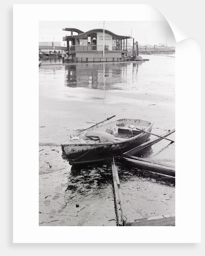 Oil-Slicked Boat Washed On Oiled Beach by Corbis