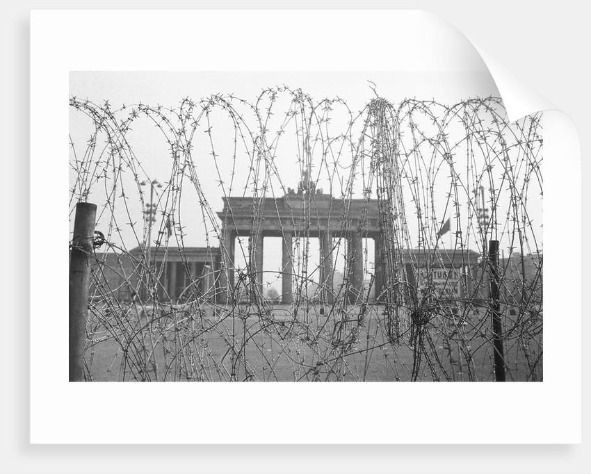 Barbed Wire and Brandenburg Gate by Corbis