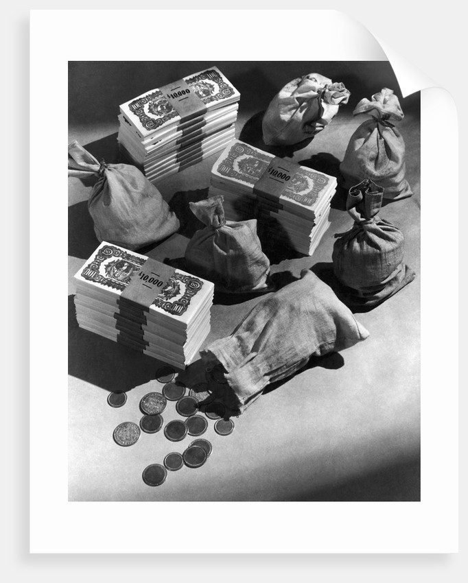 Stacks of $100 Bills, Coins, and Money Bags by Corbis