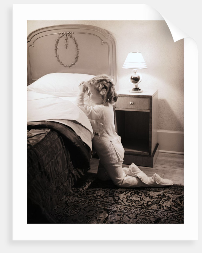 Girl Praying at Bedside by Corbis