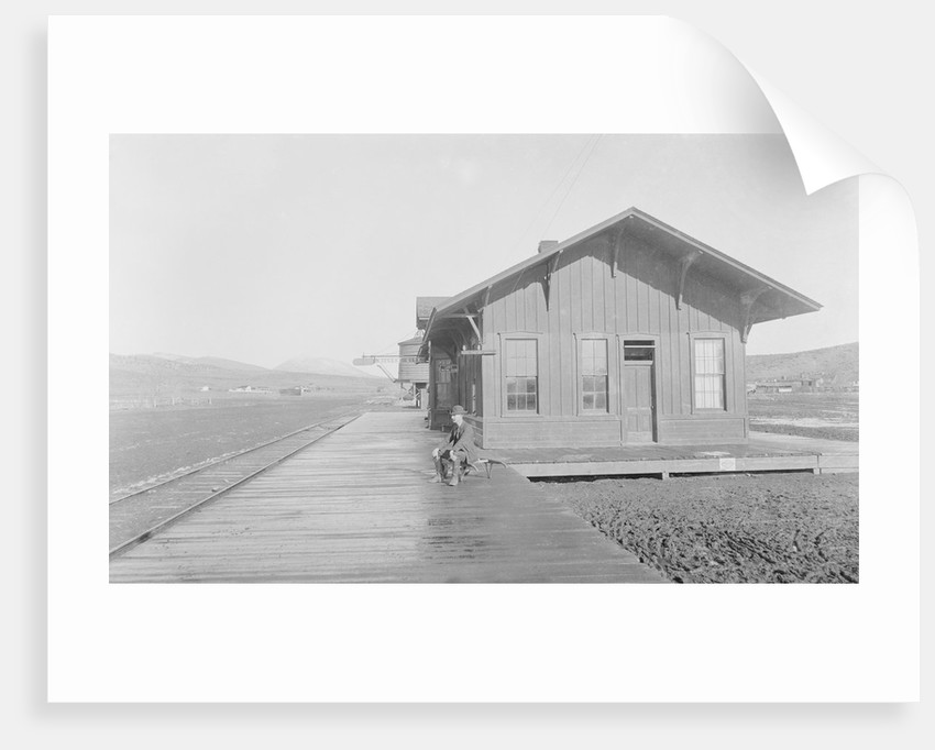Man Waiting at Railroad Station by Corbis