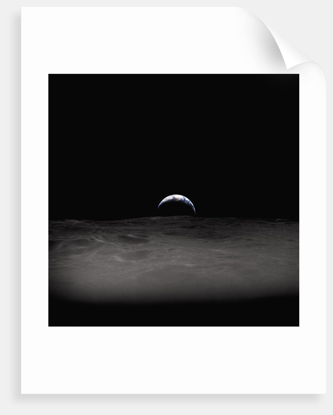Earth Setting Behind the Moon by Corbis