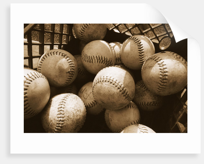 Crate Full of Worn Softballs by Corbis