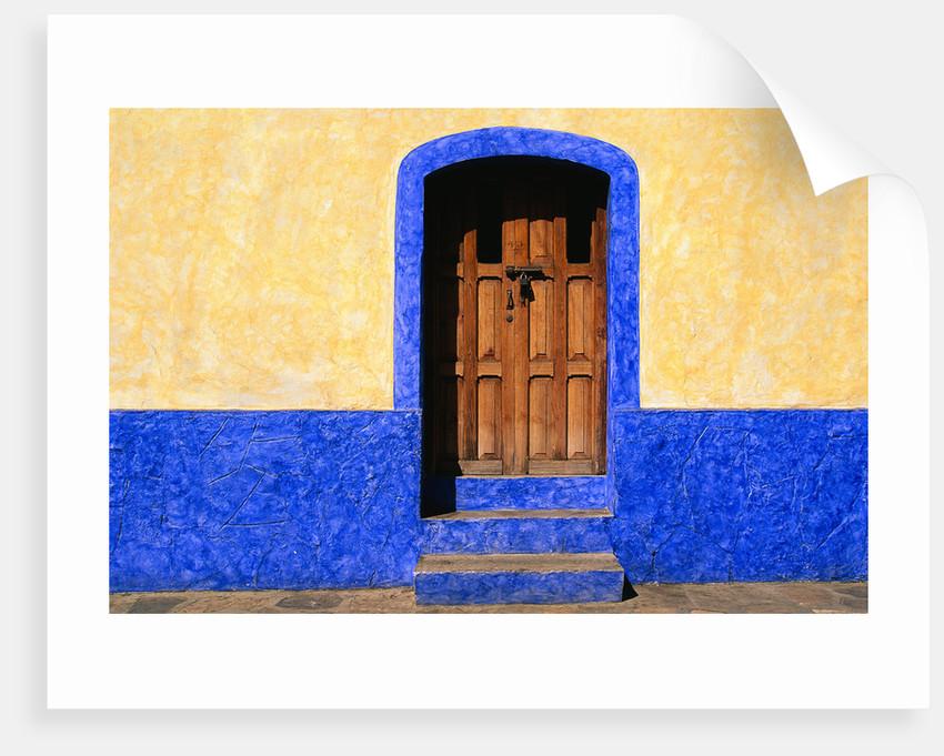 Door in Yellow and Blue House by Corbis