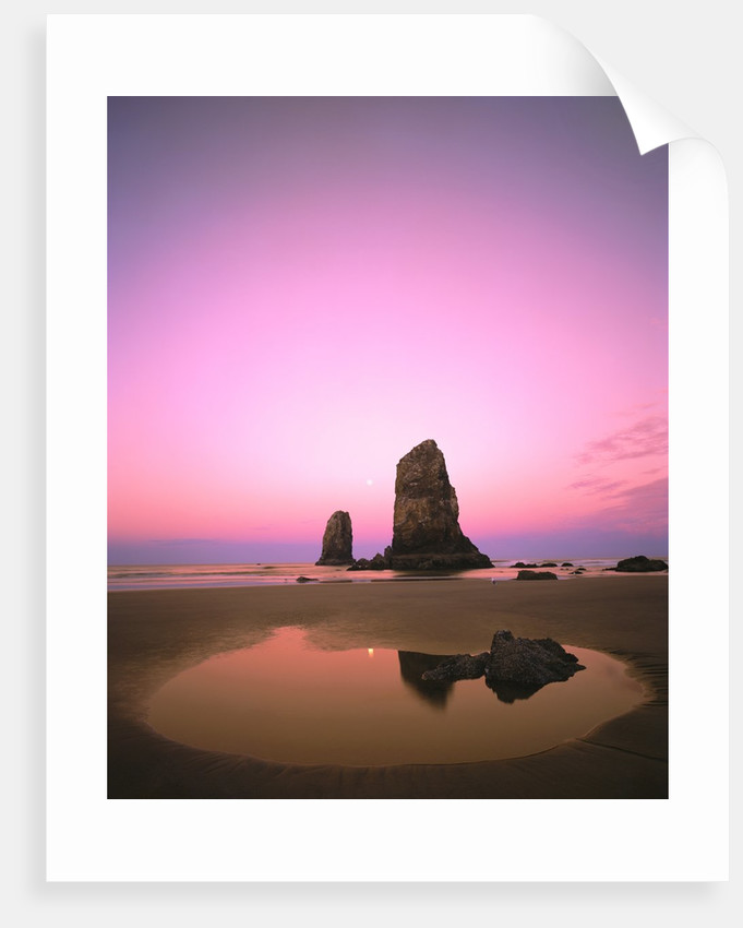 Dusk Settling Over Coastal Rock At Cannon Beach By Corbis