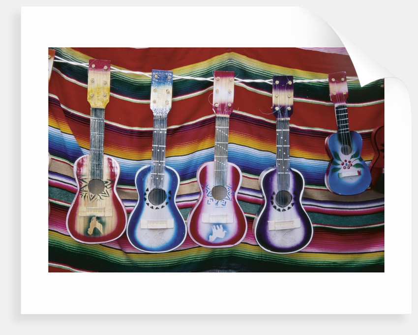 Colorful Guitars Drying by Corbis