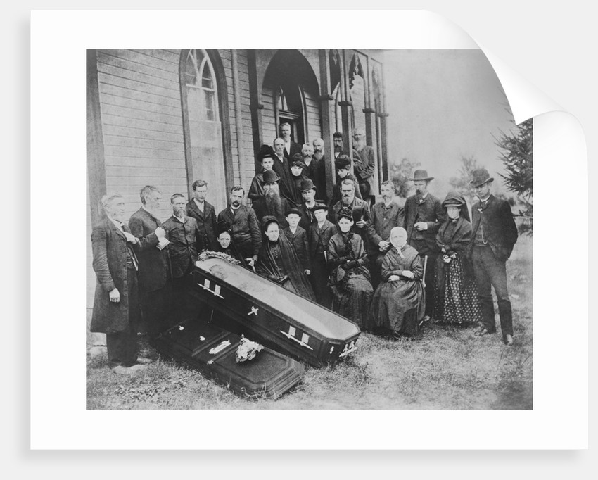 Family with Open Coffin by Corbis