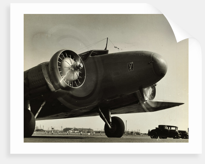 View of Airplane Nose with Propellers Spinning by Corbis