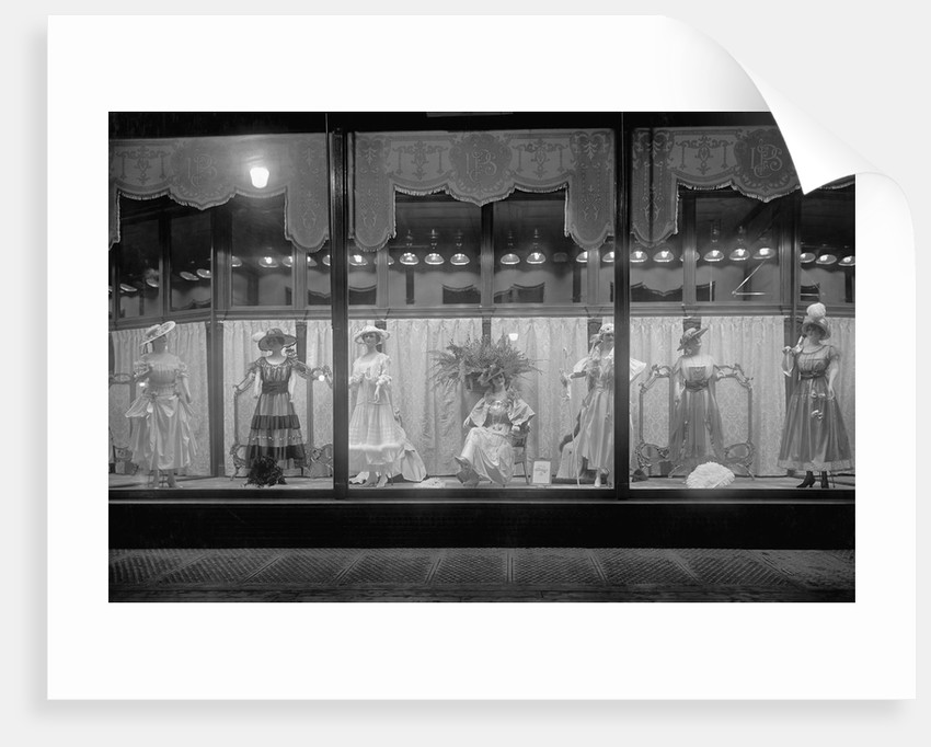 Dress Display in a Store Window by Corbis