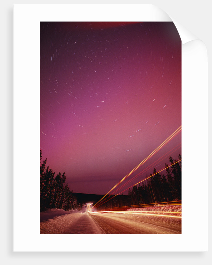 Aurora Borealis over Alaska Highway by Corbis