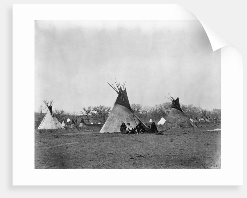 A Native American Family Sits Outside Their Teepee by Corbis