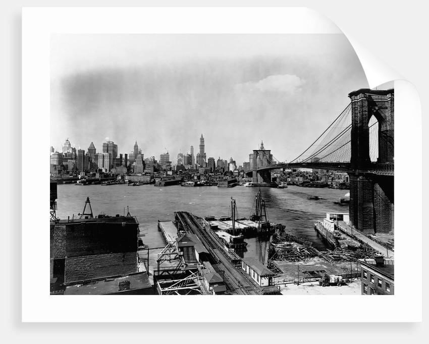 Manhattan Skyline, East River and Brooklyn Bridge by Corbis