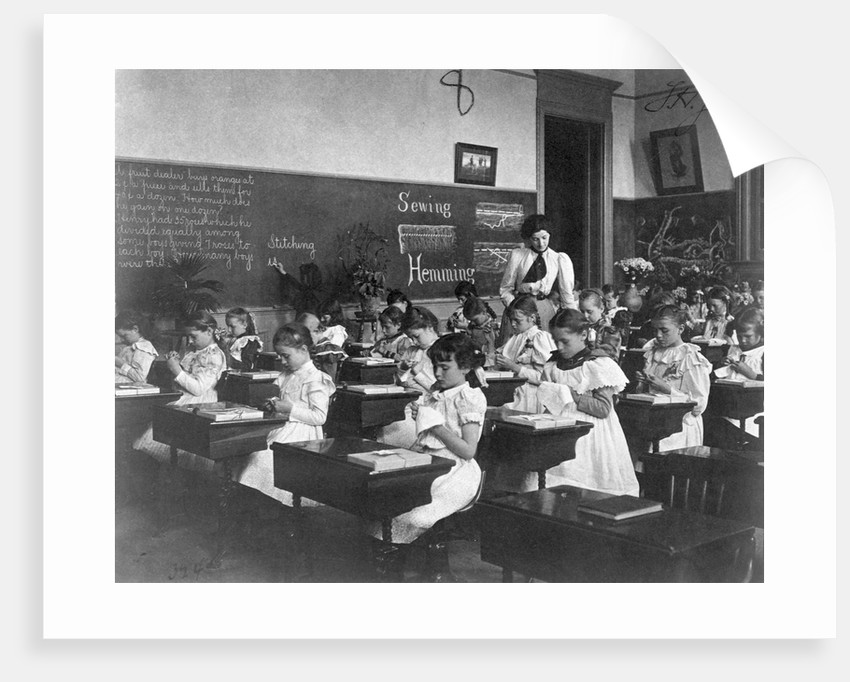 Elementary School Girls Learning Sewing by Corbis