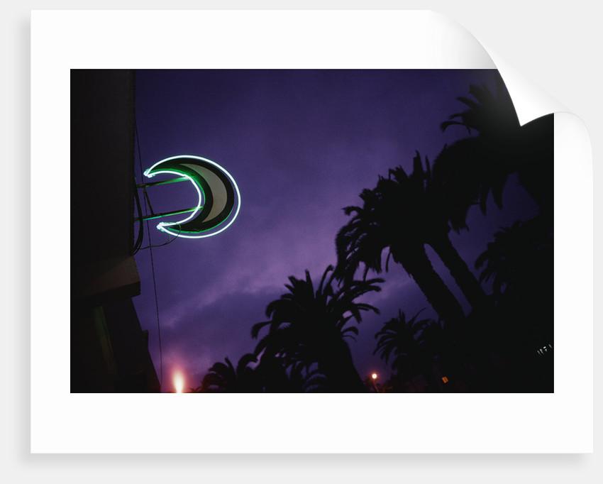 Neon Crescent Moon Above Pharmacy by Corbis