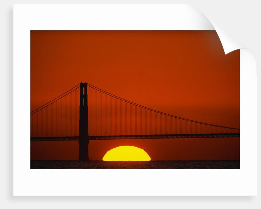 Sunset Behind the Golden Gate Bridge by Corbis