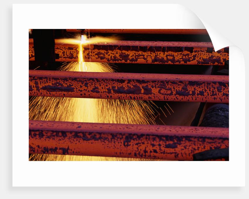 Steel Bars Being Cut by Corbis