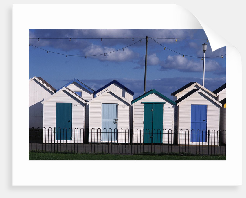 Beach Huts on Devon Town's Waterfront by Corbis