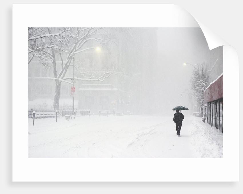 Pedestrian Walking Along Snowy Street by Corbis