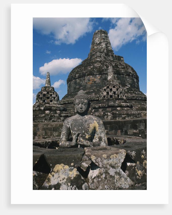 Buddhist Statues on Stupas by Corbis