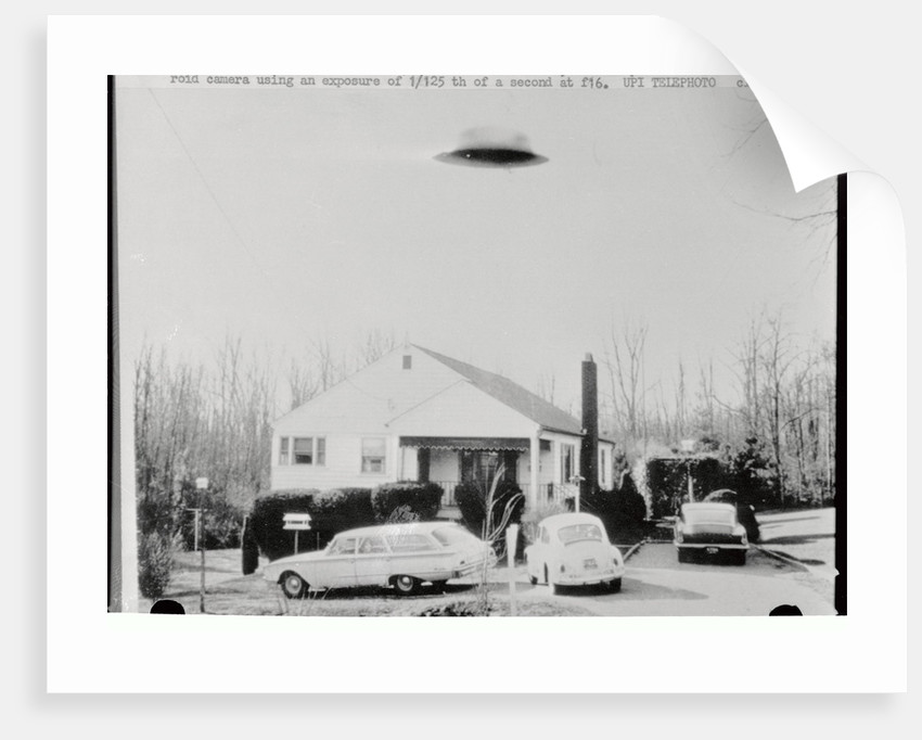Supposed Unidentifiable Flying Object over House by Corbis