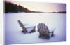 Two Snow-covered Chairs Outdoors by Corbis