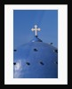 Blue dome of a church with cross on Santorin, Greece by Corbis