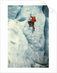 Mountain climber at ice wall by Corbis