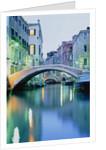 Bridge above a channel in Venice, evening shot by Corbis