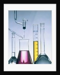 Different flasks with fluids by Corbis