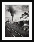 Freight train in front of smoking chimney stacks, nostalgia by Corbis