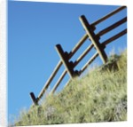 Low angle view of rustic wooden fence by Corbis