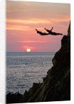 Acapulco Cliff Divers at Sunset by Corbis