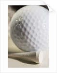 Golf Ball and Golf Tee by Corbis