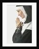 Praying Nun Holding Rosary by Corbis