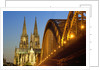 Cologne Cathedral and Hohenzollern Bridge on Rhine River by Corbis