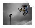 BMX Biker Performing Tricks by Corbis
