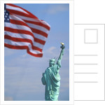 Statue of Liberty and American Flag by Corbis
