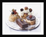 French Pastries on Silver Plate with Doily by Corbis