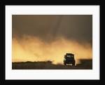 SUV Driving Across Savanna by Corbis
