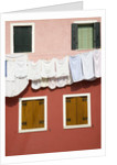 Brightly Colored House With Washing Line by Corbis