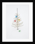 White Christmas Tree in Snow by Corbis