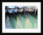 Gondolas Moored on Canal in Venice by Corbis