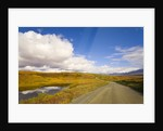 Clouds Above Autumn Tundra and Gravel Road in Alaska by Corbis