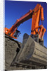 Backhoe Working on Muddy Construction Site by Corbis