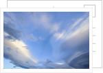 Bright Cumulus and Lenticular Clouds at Sunrise by Corbis