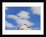 Clouds above Mountain Peak by Corbis