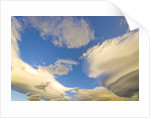 Cumulus and Lenticular Clouds at Sunrise by Corbis